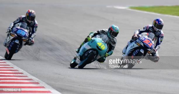 Leoperd Racing's rider Italian Lorenzo Dalla Porta leeds to win over Del Conca Gresini Moto3's Italian Fabio Di Giannantonio and Del Conca Gresini...