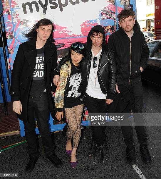 Leopold Ross Akiko Matsuura Robbie Furze and Milo Cordell of The Big Pink pose beside the MySpace bus during the Camden Crawl festival in Camden Town...