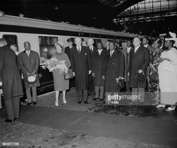 Leopold Sedar Senghor , the President of Senegal, and his wife Colette are met by British Prime Minister Harold Macmillan and Foreign Secretary Alec...