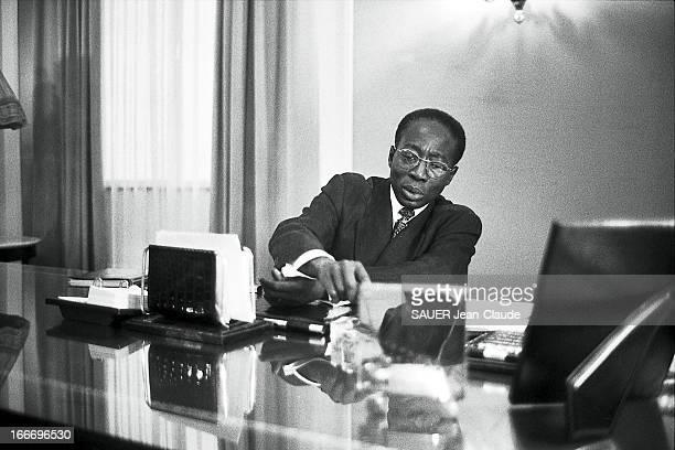 Leopold Senghor In His Office. Léopold SENGHOR assis derrière son bureau à DAKAR..