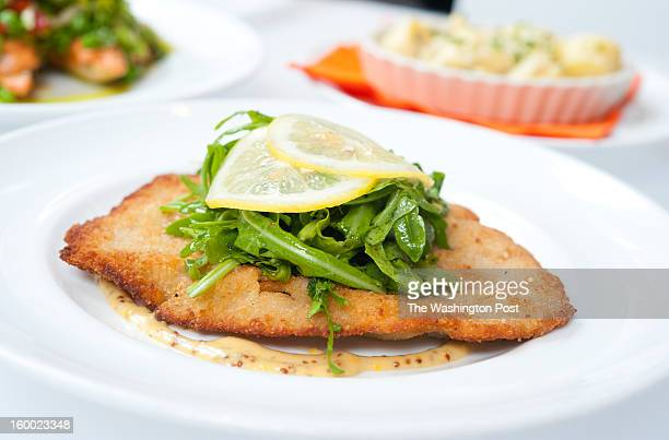 Leopold's Schnitzel is pictured It is veal schnitzel arugula mustard lemon dressing and served with a austrian potato salad $2500 Kafe Leopold in...