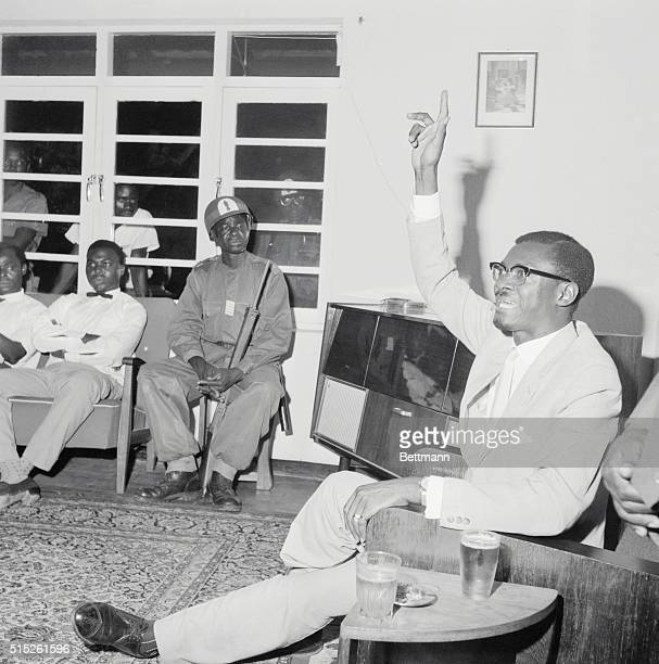 Press Conference at Leopoldville Deposed Premier Patrice Lumumba held an improvised press conference under the guard of the Public Forces soldiers...