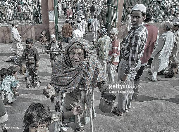 Leper with hands out stretched on the steps of the JAMA MASJID mosque in OLD DELHI beggars line these steps to beg during and after prayer