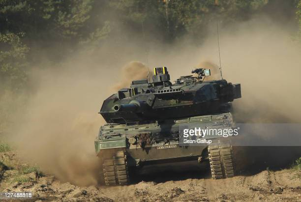 Lepoard 2 battle tank of the German Bundeswehr armed forces takes part in a demonstration for visitors prior to military exercises on September 28...