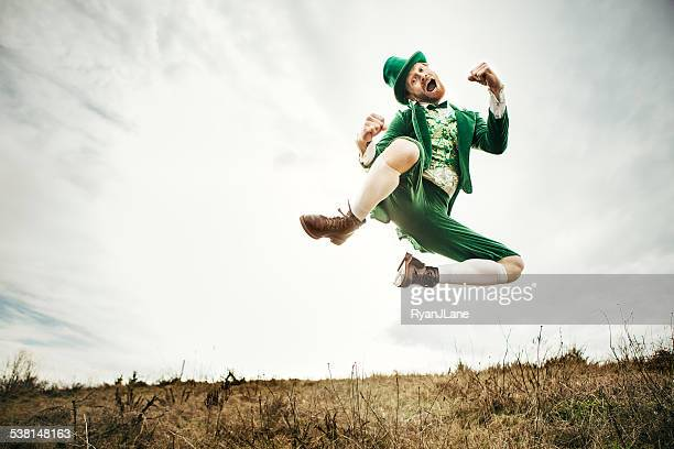 leprechaun man dancing on st. patricks day - st patricks day stock pictures, royalty-free photos & images