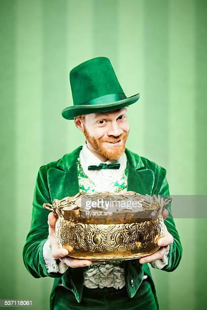 leprechaun man with pot of gold - st patrick's day stock pictures, royalty-free photos & images
