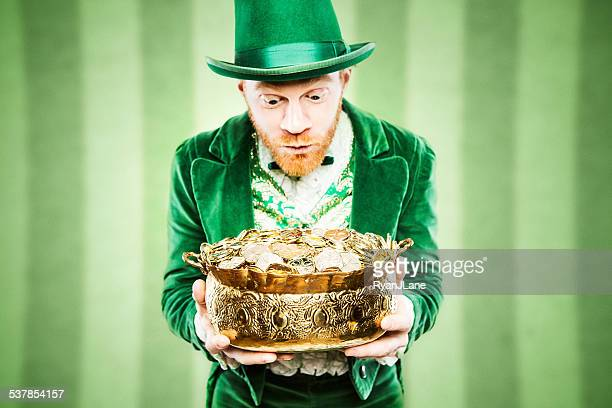 leprechaun man with pot of gold - st patricks stock pictures, royalty-free photos & images