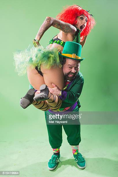 A leprechaun of Super Geek League carries a Lady of Emerald backstage during the USC Lucky Festival on March 12 2016 at The Tacoma Dome in Tacoma...