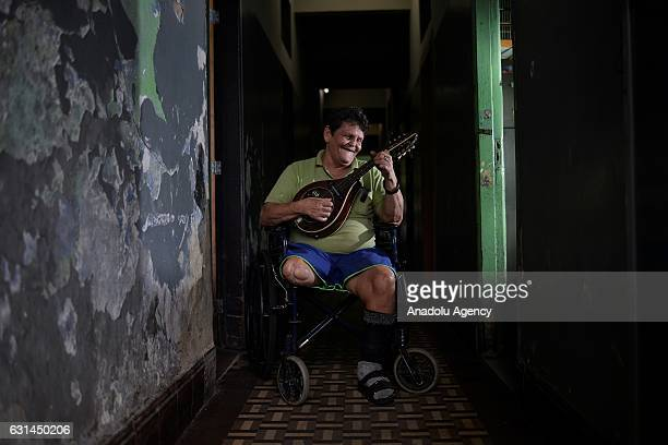 A leprosy patient in a wheelchair plays mandolin at Curupaiti colony hospital in Jacarepagua district of Rio de Janeiro Brazil on May 13 2016...