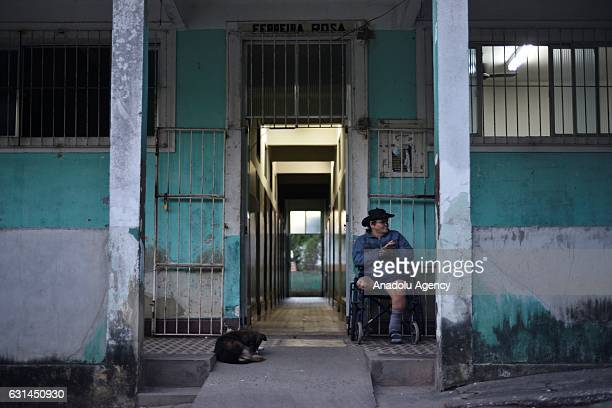 A leprosy patient in a wheelchair sits outside of Curupaiti colony hospital in Jacarepagua district of Rio de Janeiro Brazil on June 15 2016 Hospital...