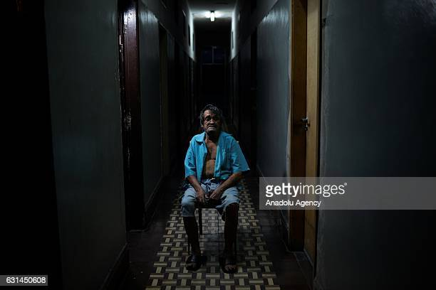 A leprosy patient poses as he sits on a chair at Curupaiti colony hospital in Jacarepagua district of Rio de Janeiro Brazil on May 18 2016 Hospital...