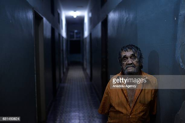 A leprosy patient poses at Curupaiti colony hospital in Jacarepagua district of Rio de Janeiro Brazil on May 25 2016 Hospital Colonia was abandoned...