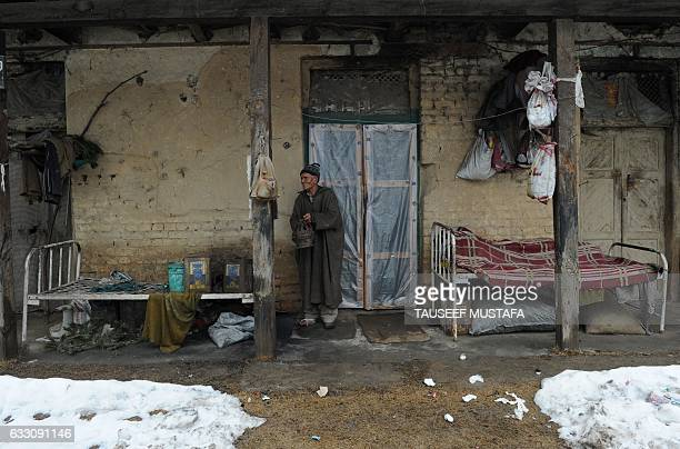 A leprosy patient stands outside his room at the leprosy hospital in downtown Srinagar on January 30 2017 World Leprosy Day is observed on January 30...