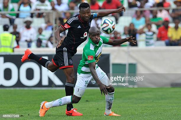 Lerato Lamola of Celtics and Siyabonga Sangweni of Pirates competes during the Absa Premiership match between Bloemfontein Celtic and Orlando Pirates...