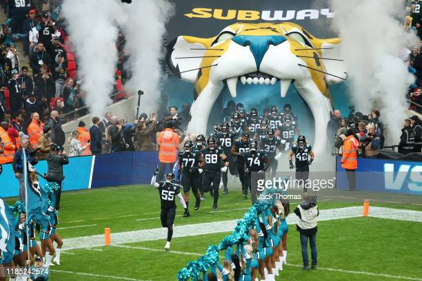 Lerentee McCray of the Jacksonville Jaguars leads his team out onto the pitch prior to the NFL match between the Houston Texans and Jacksonville...
