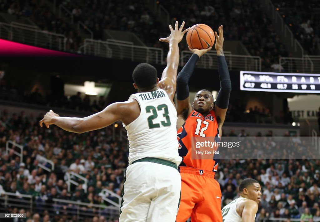 Leron Black #12 of the Illinois Fighting Illini shoots over Xavier Tilman #23 of the Michigan State Spartans at Breslin Center on February 20, 2018 in East Lansing, Michigan.