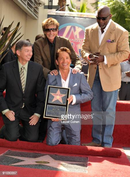 Leron Gubler Barry Manilow Chris Gardner pose with Jazz Musician Dave Koz who is getting honored with a star on the Hollywood Walk Of Fame on...
