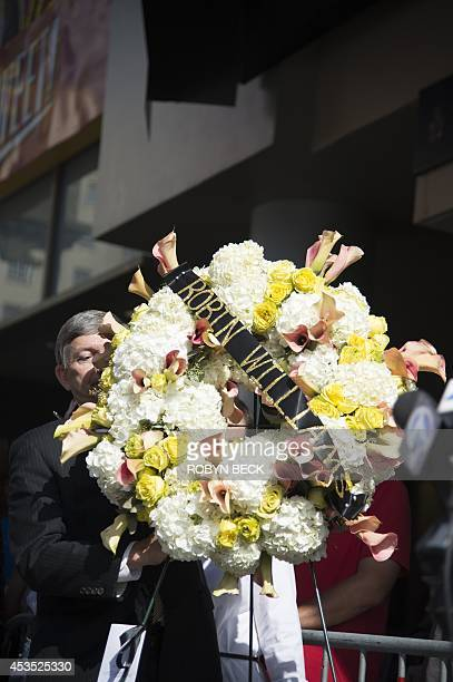 Leron Gubler president and CEO of the Hollywood Chamber of Commerce places a wreath at actor/comedian Robin Williams' star on the Hollywood Walk of...