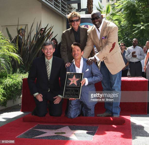 Leron Gubler recording artist Dave Koz Barry Manilow and Chris Gardner pose for photographers during ceremony honoring Koz with a star on the...