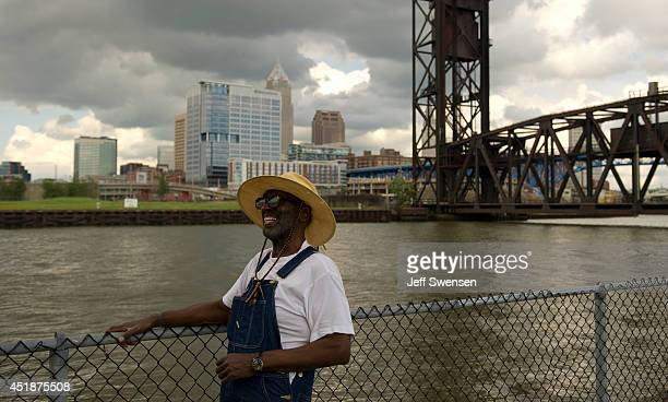Leroy Berts fishes in the Cuyahoga River with a background of downtown Cleveland which has been chosen for the 2016 Republican National Convention on...