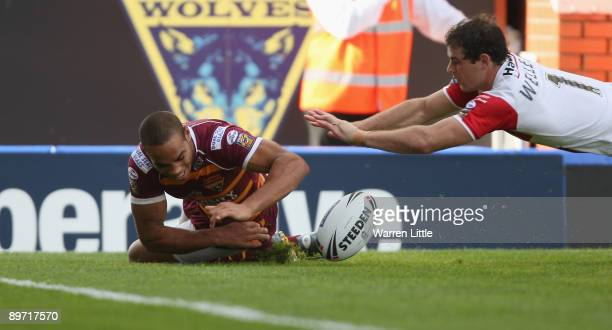 Leroy Cudjoe of Huddersfield dives over to score a try during the semifinal match of the Carnegie Challenge Cup between St Helens and Huddersfield...