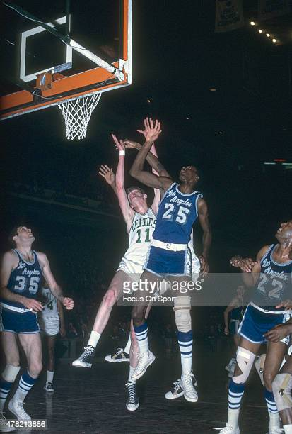 Leroy Ellis of the Los Angeles Lakers battles for a rebound with Mel Counts of the Boston Celtics during an NBA basketball game circa 1965 at the...