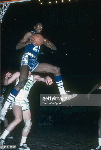Leroy Ellis of the Los Angeles Lakers comes down with a rebound against the Boston Celtics during an NBA basketball game circa 1965 at the Boston...