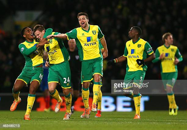 Leroy Fer and Russell Martin of Norwich City congratulate Ryan Bennett of Norwich City on scoring their first goal during the Barclays Premier League...