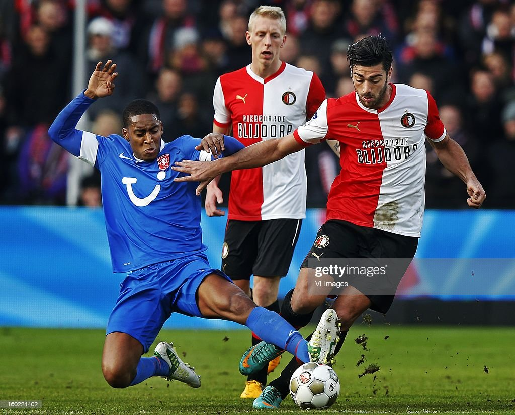 Leroy Fer of FC Twente (L), Graziano Pelle of Feyenoord (R) during the Dutch Eredivise match between Feyenoord and FC Twente at stadium De Kuip on January 27, 2013 in Rotterdam, The Netherlands.