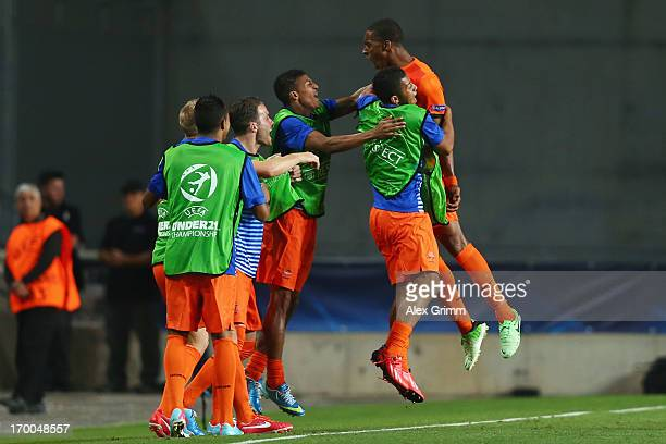 Leroy Fer of Netherlands celebrates his team's third goal with team mates during the UEFA European Under 21 Championship match between Netherlands...