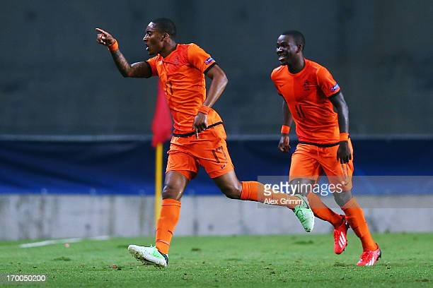 Leroy Fer of Netherlands celebrates his team's third goal with team mate Ola John during the UEFA European Under 21 Championship match between...