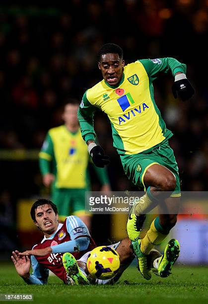 Leroy Fer of Norwich City beats James Tomkins of West Ham United to score their third goal during the Barclays Premier League match between Norwich...