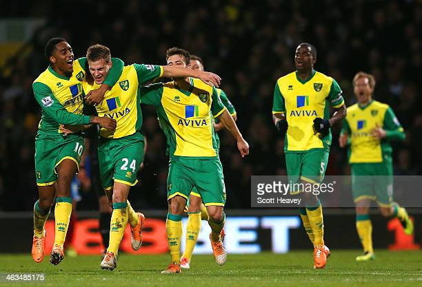 Leroy Fer of Norwich City congratulates Ryan Bennett of Norwich City on scoring their first goal during the Barclays Premier League match between...
