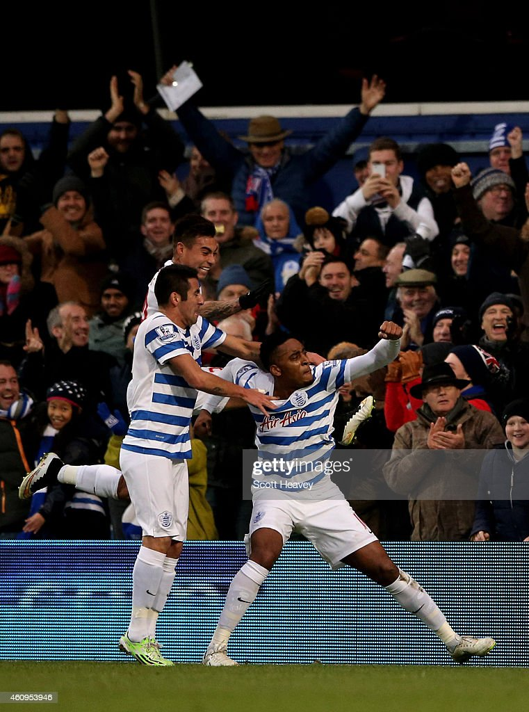 Leroy Fer (R) of QPR celebrates with teammates after scoring the opening goal during the Barclays Premier League match between Queens Park Rangers and Swansea City at Loftus Road on January 1, 2015 in London, England.