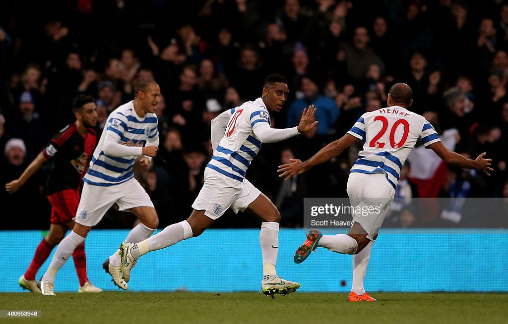 Leroy Fer (C) of QPR celebrates with teammates after scoring the opening goal during the Barclays Premier League match between Queens Park Rangers and Swansea City at Loftus Road on January 1, 2015 in London, England.