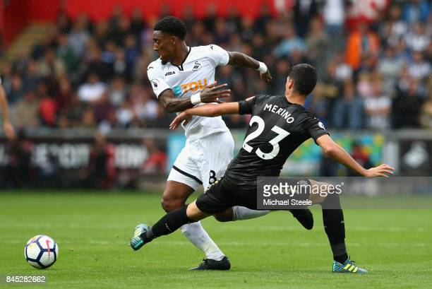 Leroy Fer of Swansea City and Mikel Merino of Newcastle United in action during the Premier League match between Swansea City and Newcastle United at...