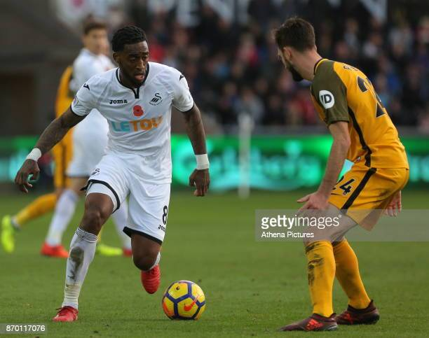 Leroy Fer of Swansea City attempts to get past Davy Propper of Brighton during the Premier League match between Swansea City and Brighton and Hove...