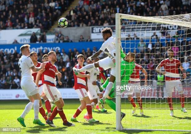 Leroy Fer of Swansea City attempts to head towards goal but colides with Victor Valdes of Middlesbrough during the Premier League match between...