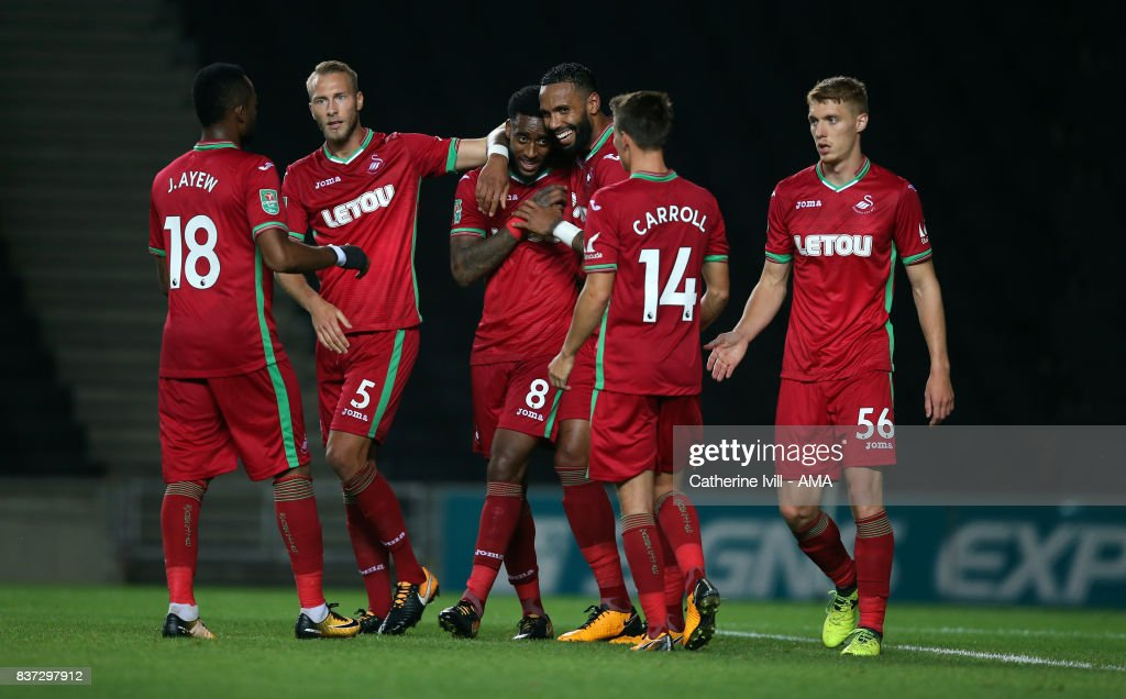 Leroy Fer of Swansea City celebrates with his team mates after scoring to make it 1-2 during the Carabao Cup Second Round match between Milton Keynes Dons and Swansea City at StadiumMK on August 22, 2017 in Milton Keynes, England.