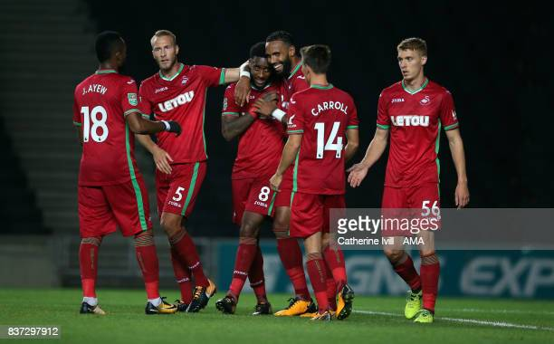 Leroy Fer of Swansea City celebrates with his team mates after scoring to make it 12 during the Carabao Cup Second Round match between Milton Keynes...