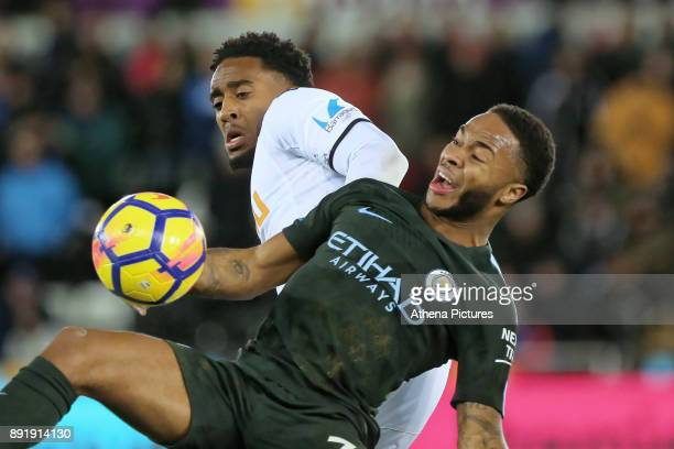 Leroy Fer of Swansea City challenges Raheem Sterling of Manchester City during the Premier League match between Swansea City and Manchester City at...