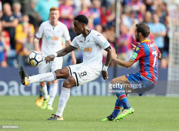 Leroy Fer of Swansea City chips the ball over Yohan Cabaye of Crystal Palace during the Premier League match between Crystal Palace and Swansea City...