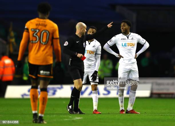 Leroy Fer of Swansea City gets a red card from referee Anthony Taylor during the The Emirates FA Cup Third Round match between Wolverhampton...