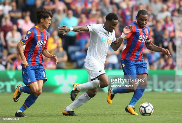 Leroy Fer of Swansea City is marked by Lee Chungyong and Jason Puncheon of Crystal Palace during the Premier League match between Crystal Palace and...