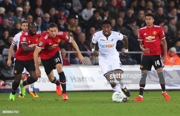 Leroy Fer of Swansea City is marked by Nemanja Matic of Manchester United during the Carabao Cup Fourth Round match between Swansea City and...