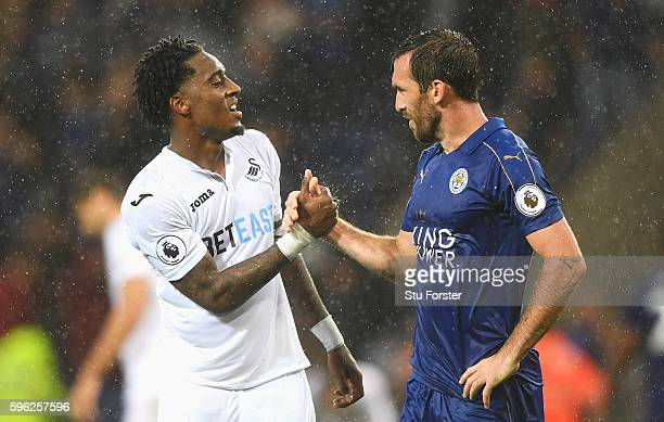 Leroy Fer of Swansea City shakes hands with Christian Fuchs of Leicester City after the final whistle during the Premier League match between...