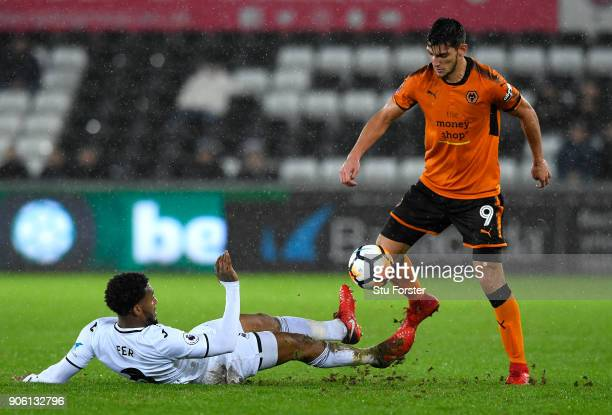 Leroy Fer of Swansea City tackles Rafa Mir of Wolverhampton Wanderers during The Emirates FA Cup Third Round Replay between Swansea City and...