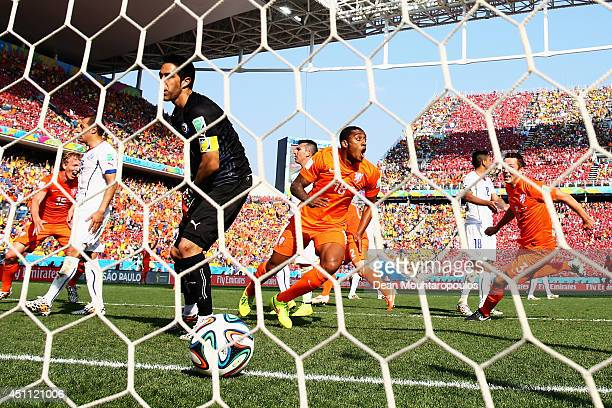 Leroy Fer of the Netherlands celebrates after he scores his team's first goal past Claudio Bravo of Chile during the 2014 FIFA World Cup Brazil Group...