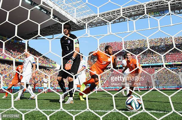 Leroy Fer of the Netherlands celebrates scoring his team's first goal past Claudio Bravo of Chile during the 2014 FIFA World Cup Brazil Group B match...
