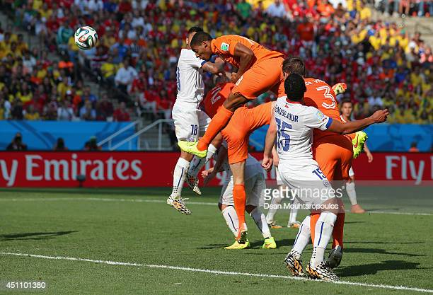 Leroy Fer of the Netherlands scores his team's first goal on a header during the 2014 FIFA World Cup Brazil Group B match between the Netherlands and...
